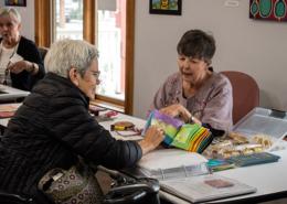 Artist Gloria Shelton conversing about hand stitch