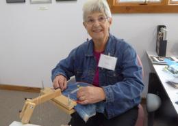Artist Jill Taylor demonstrating hand Goldwork