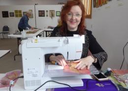 Artist Christina Fairley Erickson demonstrates machine Goldwork