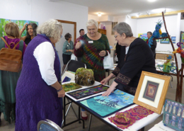Artist June Steegstra explaining her work with Quilt and Fiber Art Museum Director Amy Green