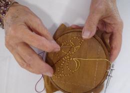 Artist in residence Gloria Shelton working on hand Goldwork
