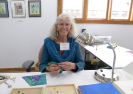Artist in residence Nancy Drake showing bead embroidery